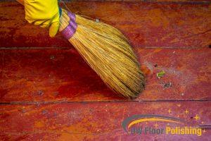 cleaning-debris-on-wood-floor-wood-polishing-floor-polishing-singapore