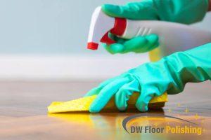 homeowner-spraying-wooden-floor-wood-polishing-floor-polishing-singapore