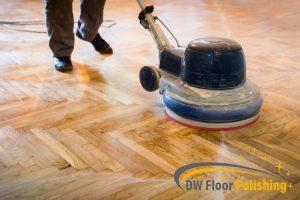 homeowner-vacuuming-parquet-floor-parquet-varnishing-floor-polishing-singapore